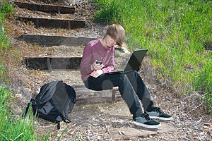 Teen with Laptop and Phone