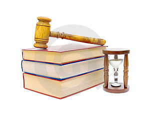 Hourglass, books and judges gavel