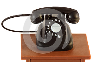 Little retro telephone on table isolated