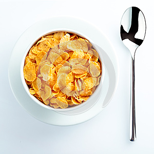 Bowl of cereal and spoon set for breakfast