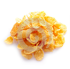 Small sampling of corn flakes in a pile