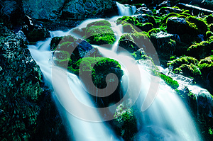 Water Falling Over Mossy Rocks