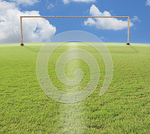 Goal o football on green grass blue sky