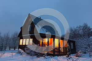 Country house (dacha) in winter dawn. Russia.