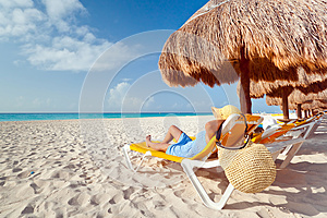 Woman at relaxation under parasol