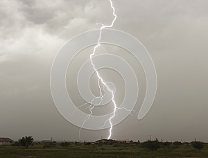 A Lightning Bolt Strikes a Rural Home