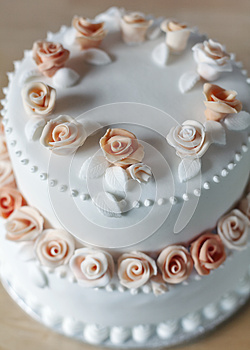 Wedding cake with rose decorations