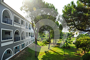 Garden view with trees and hotel in summer resort (Zakynthos, Greece)
