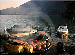 Sunset barbecue with boats