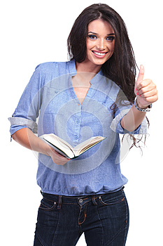 Casual woman with book shows thumb up