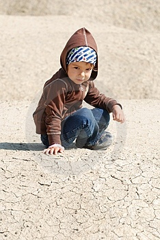 Cute toddler playing in dirt