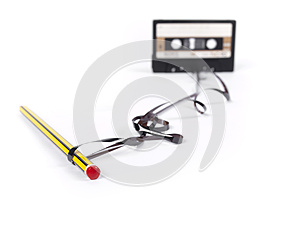 Retro cassette with loose tape and a pencil