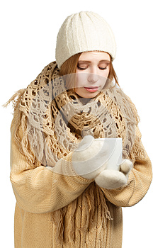 Young woman in warm clothing with mug