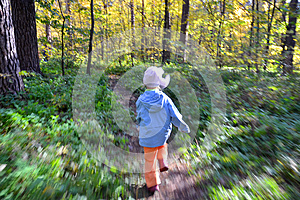 Child runs through the forest