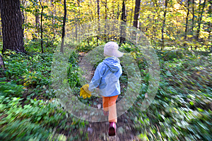The child runs through the forest