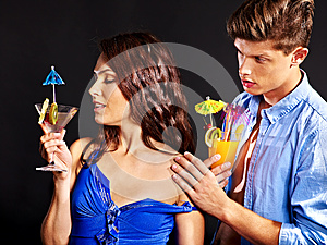 Couple with glass of cocktail.