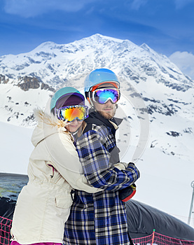 Happy young couple in mountains