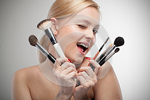 Young smiling woman with make up