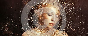 Art photo of golden woman splintering to thousands elements