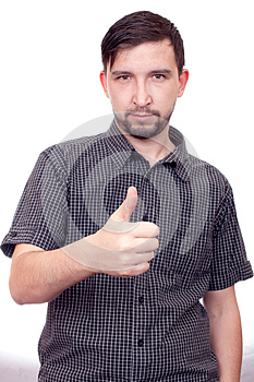 Young casual man showing the thumb up gesture