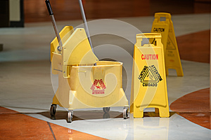 Janitorial Mop and Caution Sign