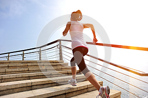 Healthy lifestyle woman legs running on stone stai