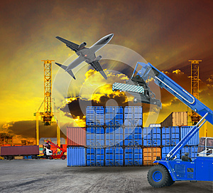 Logistic business working in container shipping yard with dusky sky and jet plane cargo flying above use for land to air transport