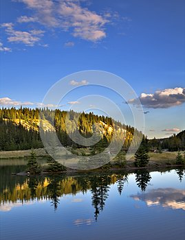 Lake and forested mountains
