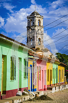 Colorful traditional houses and old church tower in the colonial town of Trinidad, Cuba
