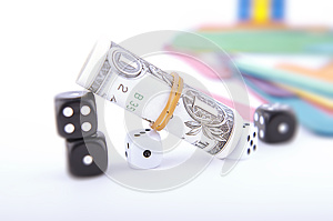 Tilted Dollar Bill With Black and White Dice