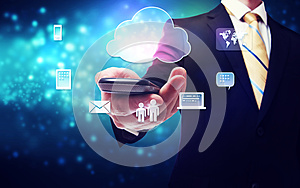 Business man holding a mobile phone with cloud connection theme