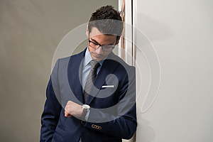 Handsome Businessman Checking Time On His Watch