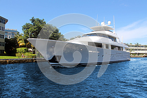 Luxury yacht in front of house
