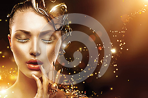 Model girl face with gold make-up and accessories