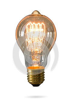 Glowing yellow light bulb isolated