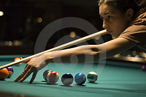 Girl playing billiard