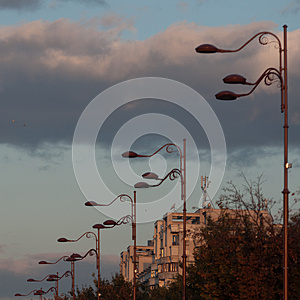 Block of flats and light poles at sunrise