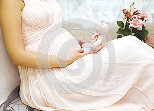 Pregnancy, motherhood and happy future mother concept - woman