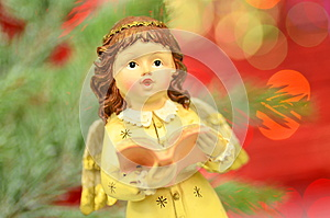 Christmas decoration, figure of little angel singing carols