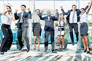 Diversity business team jumping celebrating success