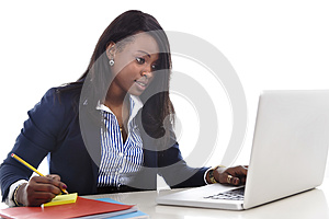 Attractive and efficient black ethnicity woman sitting at office computer laptop desk typing