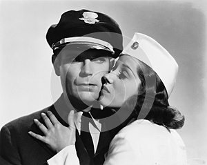 Pilot and stewardess having romantic moment