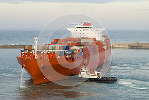 Container vessel and a small tug boat