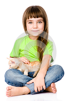 Little girl stroking a kitten. isolated on white background