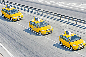 Three taxis on motorway