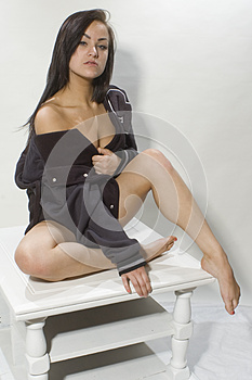 Woman posing on table top