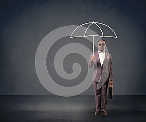Businessman holding an umbrella.