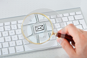 Looking at mail key through magnifying glass