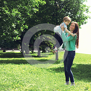 Life moment of happy family! Mother and son child playing