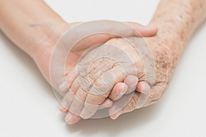 Help concept,The helping hands for elderly home care.